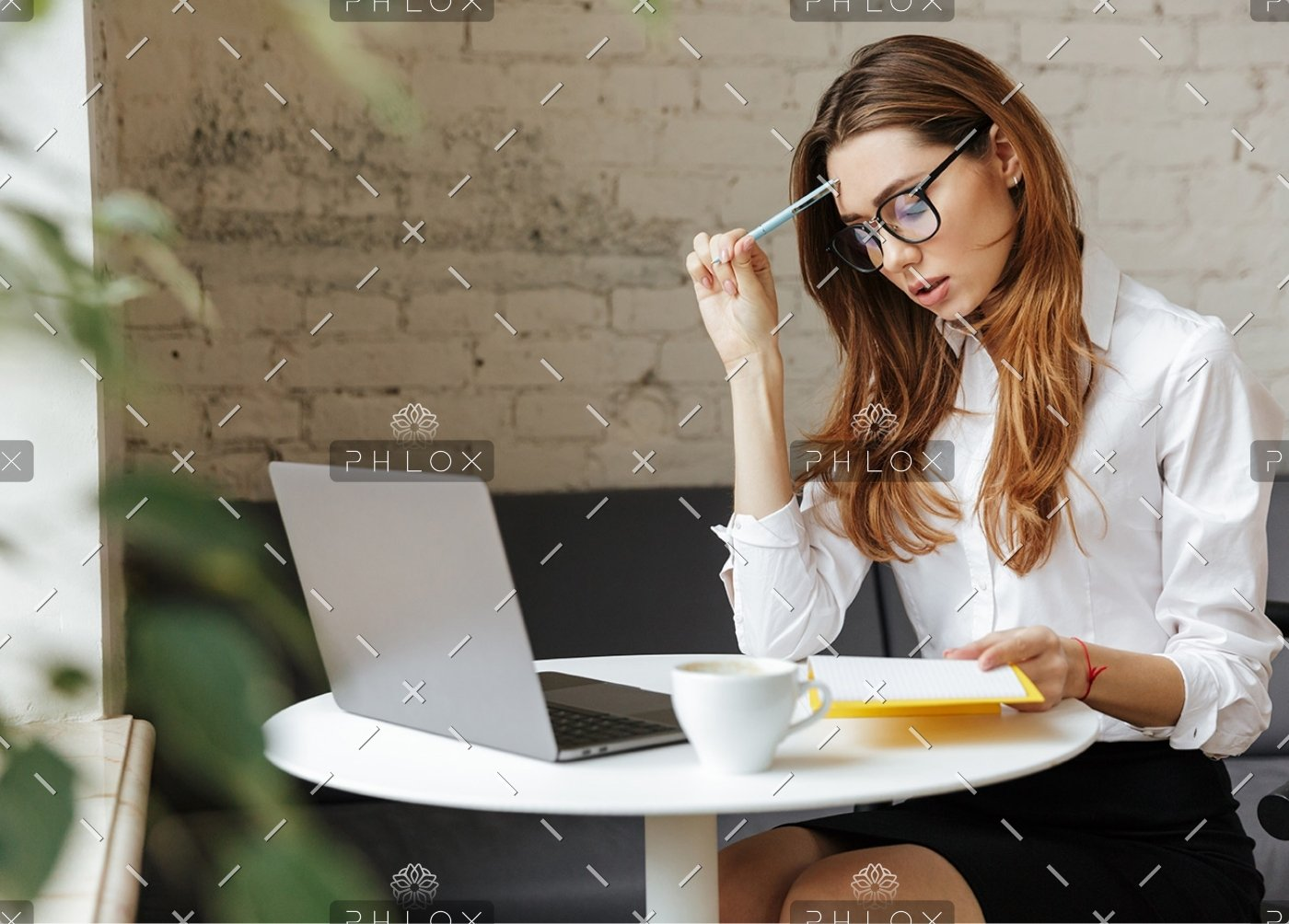 demo-attachment-407-thoughtful-business-woman-indoors-using-laptop-P5HYUQX